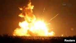Unmanned Antares rocket is seen exploding seconds after lift off from a commercial launch pad in this still image from NASA video at Wallops Island, Virginia, Oct. 28, 2014.