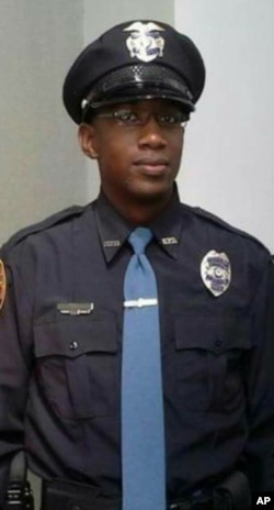 This undated photo released by the Hattiesburg Police Department, shows Officer Liquori Tate in Hattiesburg, Miss.