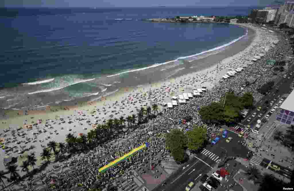 Demonstrators attend a protest against Brazil's President Dilma Rousseff, part of nationwide protests calling for her impeachment, in Copacabana in Rio de Janeiro.