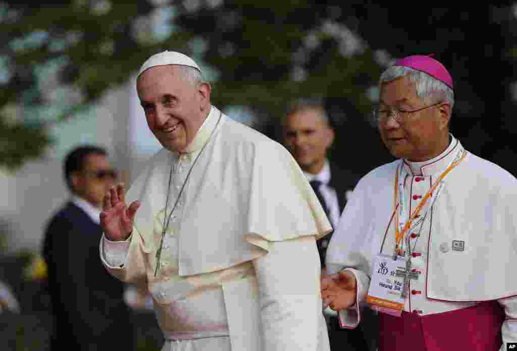 Pope Francis waves during his visit to the birthplace of Saint Kim Taegon Andrea, also known as Saint Andrew Kim Taegon, the first Korean-born Catholic priest, Solmoe Sanctuary in Dangjin, South Korea, Aug. 15, 2014.