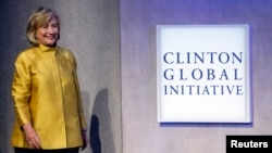 Former U.S. Secretary of State Hillary Clinton walks on stage at the Clinton Global Initiative 2014 in New York, Sept. 24, 2014.