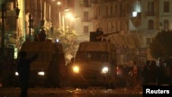 Egyptian riot police fire tear gas towards protesters during clashes in Cairo, April 6, 2013.