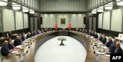 A handout made available by the Presidential Palace Press Office on Jan. 19, 2015 shows Turkey's President Recep Tayyip Erdogan (Rear) presiding over the Cabinet meeting at the presidential palace in Ankara, Jan. 19, 2015.