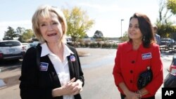 Sen. Cindy Hyde-Smith, R-Miss., left, campaigns at Mama Hamil's Restaurant in Madison, Mississippi, Nov. 6, 2018.