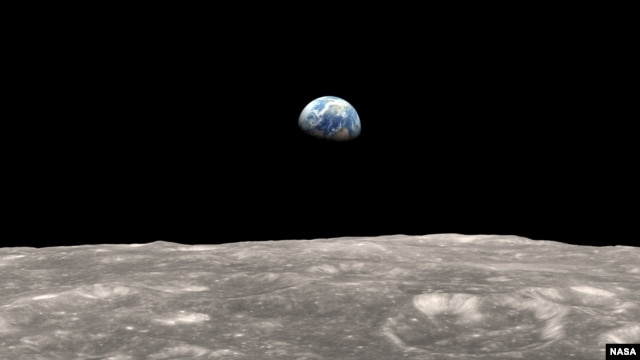 Illustration of Earth as seen from the moon. The gravitational tug-of-war between Earth and the moon raises a small bulge on the moon. The position of this bulge shifts slightly over time.