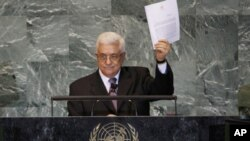 Palestinian President Mahmoud Abbas holds up a copy of the letter that he had just delivered to UN Secretary-General Ban Ki-moon requesting full UN representation for a Palestinian state, during his address before the 66th United Nations General Assembly