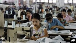 Workers in Burma. The United States has eased core financial and investment sanctions previously imposed on it, allowing U.S. companies to invest in the country for the first time in nearly 15 years.