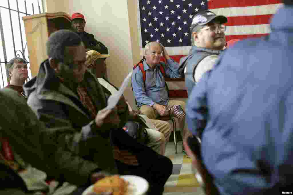 A group of veterans await a clothing giveaway at St. Anthony Foundation in San Francisco, California, Nov. 8, 2013.