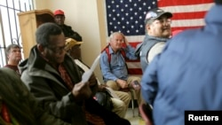 A group of veterans await a clothing giveaway at St. Anthony Foundation in San Francisco, California November 8, 2013. Homeless and low-income veterans receive free clothing such as suits, dress shirts, belts and shoes ahead of the U.S observance of Veter