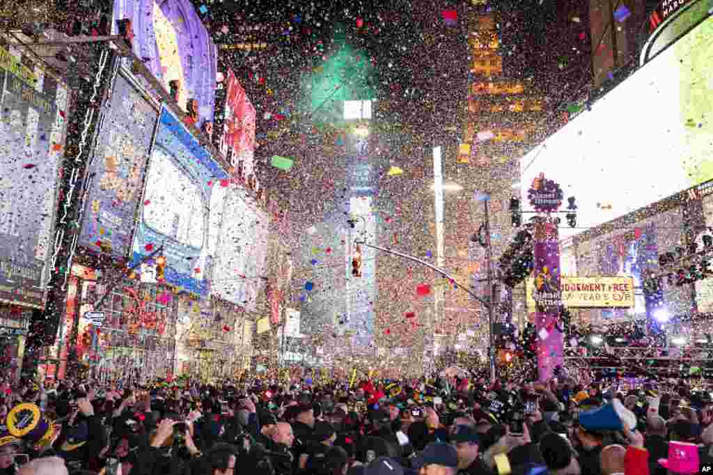 Confetti falls at midnight on the Times Square New Year's Eve celebration, in New York.