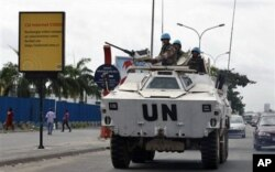 FILE - U.N. peacekeepers drive in a armored personnel carrier, in Abidjan, Ivory Coast, March 1, 2011.