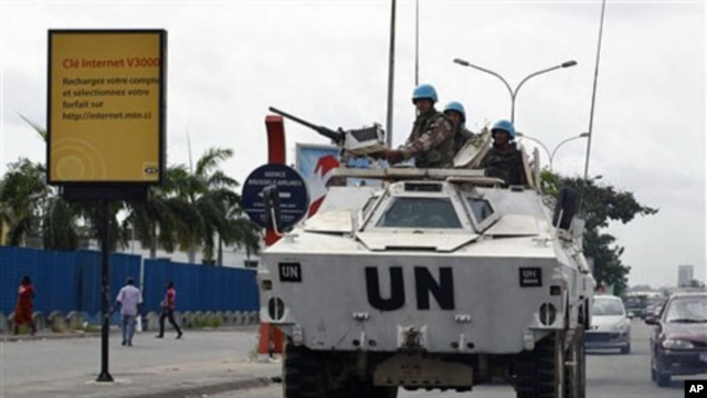 Jordanian UN soldiers drive in a armored personnel carrier, in Abidjan, Ivory Coast, March 1, 2011