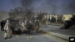 Angry Shiite Muslims burn tires as a protest against the killing of their community members by unidentified gunmen in Quetta, Pakistan, July 30, 2011