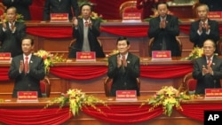 Vietnam's Communist Party leaders applaud upon their arrival at the opening ceremony of the 11th National Party Congress, Hanoi, Vietnam, Jan 12, 2011.
