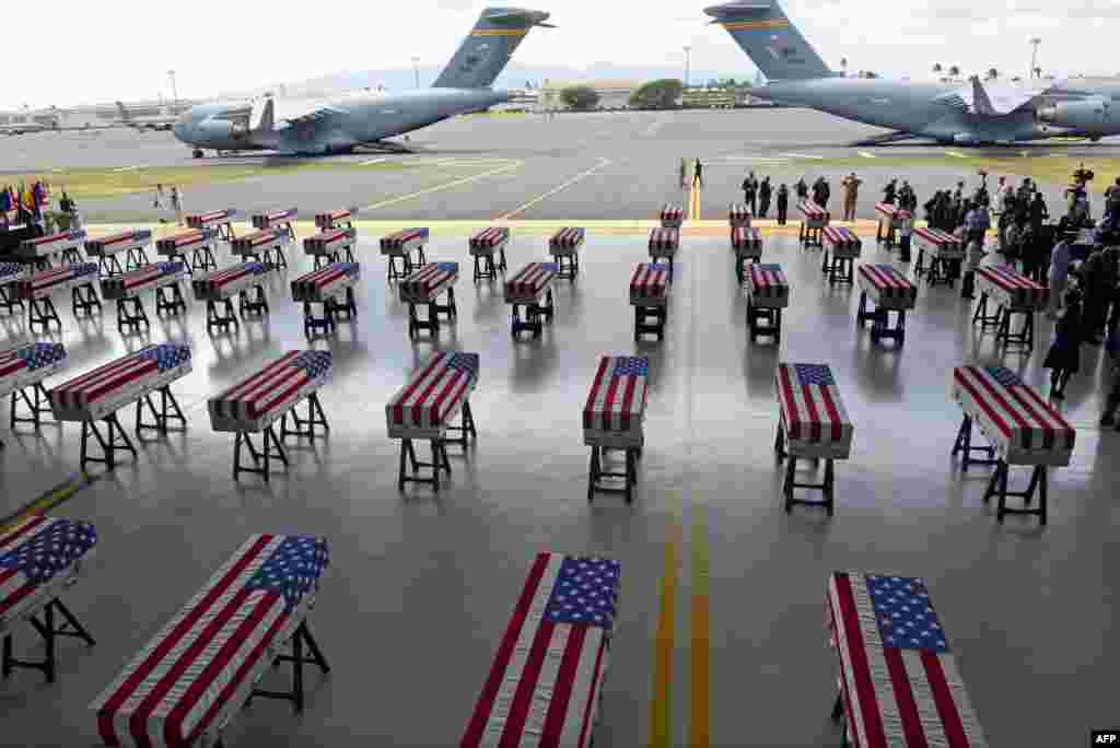 Flag hang over transfer cases with the remains of American soldiers repatriated from North Korea are seen during a repatriation ceremony after arriving at Joint Base Pearl Harbor-Hickam, Honolulu, Hawaii, Aug. 1, 2018. Sixty-five years after the Korean War ended, the remains of dozens of American soldiers killed during the brutal conflict are finally coming home.