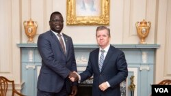 Phillip Jada Natana, South Sudan's new ambassador to the United States, meets with the Chief of the Protocol of the United States Ambassador Sean P. Lawler (right) at the State Department in Washington. (State Department photo)