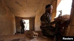 """تصویر آرشیوی از اعضای گروه کردی """"یگان مدافعان خلق"""" سوریه"""