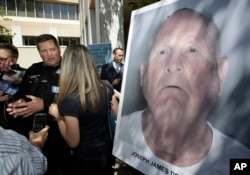 Sacramento County Sheriff Scott Jones, left, talks to reporters about the arrest Joseph James DeAngelo, seen in photo, on suspicion of committing a string of violent crimes in the 1970s and 1980s after a news conference, April 25, 2018, in Sacramento, Cal