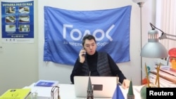 Co-chairman of Golos non-governmental organization Grigory Melkonyants speaks on the phone at his office in Moscow, Russia March 13, 2018.