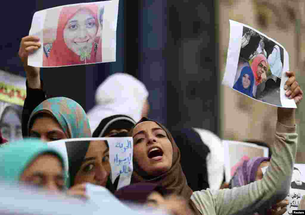 "Female relatives of women prisoners shout slogans against the military and the interior ministry at an event called ""Release Our Girls"" during International Women's Day in front of the Press Syndicate in Cairo, Egypt, March 8, 2016."