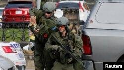 Les forces de sécurité canadiennes déployées au parlement canadien après une fusillade, le 22 octobre 2014.