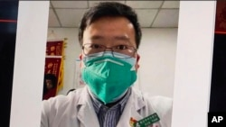 This image from video, shows a selfie of Dr. Li Wenliang. The Chinese doctor who got in trouble with authorities in the communist country for sounding an early warning about the coronavirus outbreak died Friday, Feb. 7, 2020, after coming down with…