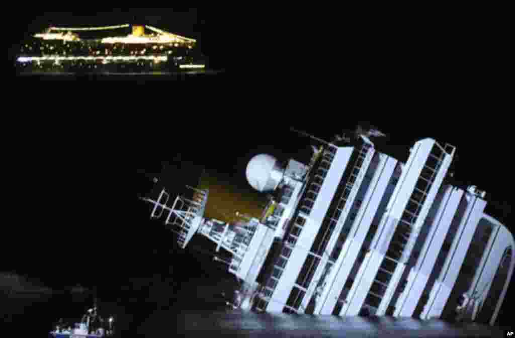 The cruise ship Costa Serena sails as its sister ship Costa Concordia cruise ship lays on its side after it ran aground off the west coast of Italy at Giglio island January 18, 2012.