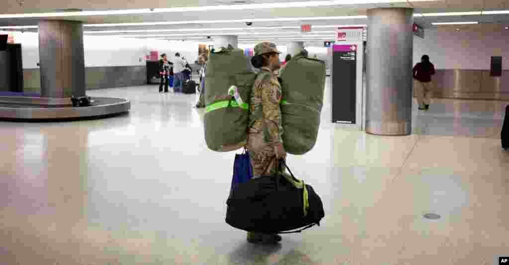 U.S. Army Sgt. Angelica Ciriaco makes her way home at the Miami International Airport, Nov. 26, 2013, after serving for 10 months in Afghanistan.