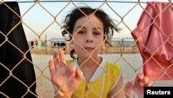 Seorang pengungsi Suriah di kamp pengungsi Al Zaatri di kota Mafraq, Yordania, dekat perbatasan Suriah (31/7).