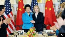 Secretary of State Hillary Clinton and Chinese State Councilor Liu Yandong at the closing meeting of the U.S.-China Consultation on People-to-People Exchange at the State Department in Washington, DC. The Young Scientist Forum is a program of the People-to-People Exchange.