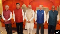 FILE - Leaders of BRICS countries, from left, Brazilian President Michel Temer, Chinese President Xi Jinping, Indian Prime Minister Narendra Modi, Russian President Vladimir Putin and South African President Jacob Zuma pose for a group photograph before a dinner hosted by Modi in Goa, India, Oct. 15, 2016.