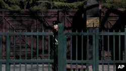 FILE - A Chinese paramilitary policeman stands guard outside the North Korean Embassy in Beijing, Feb. 7, 2016.