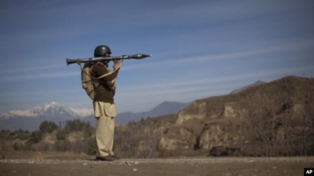 A Pakistani soldier holds a rocket launcher while securing a road in Khar, the main town in Bajaur Agency, Pakistan. (File Photo)