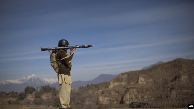 A Pakistani soldier secures a road in Khar, the main town in Bajaur Agency, located in Pakistan's Federally Administered Tribal Areas along the Afghanistan border, March 2, 2010.