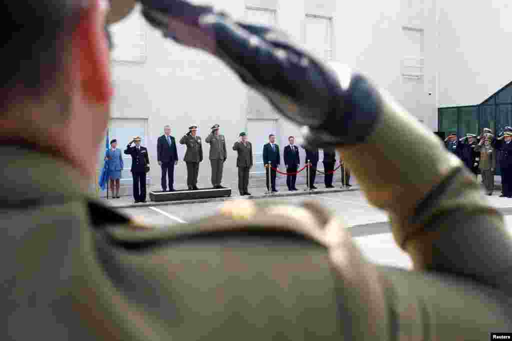 Members of the European armies listen to the European Union anthem during the transfer of authority of leadership of the European Union Atalanta Operation from UK to Spain, at the naval airbase in Rota, near Cadiz, southern Spain.