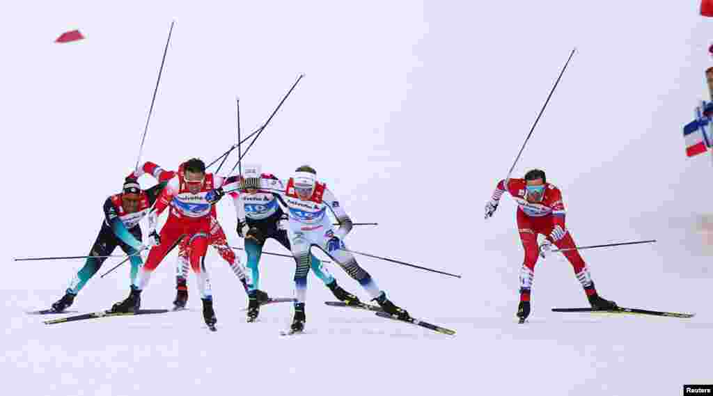 Emil Iversen of Norway, Oskar Svensson of Sweden and Gleb Retivykh of Russia compete during the semifinals of the men's sprint event during the FIS Nordic World Ski Championships in Seefeld, Austria.