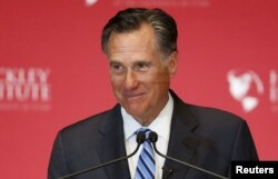 "FILE - Former Republican presidential nominee Mitt Romney, pictured during an appearance in March in Salt Lake City, says Donald Trump is setting a dangerous example by promoting ""trickle-down racism."""
