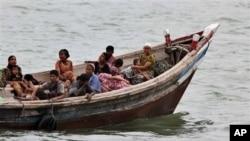 Burmese Rohingya Muslims fleeing religious violence are intercepted by Bangladesh border authorities, Taknaf, Bangladesh, June 13, 2012.