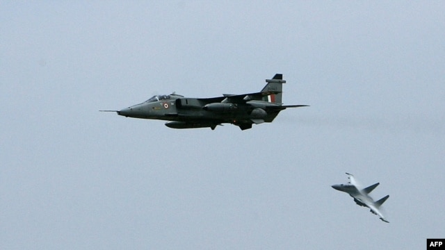 Indian fighter jets, the Mirage 2000 (L) and the Sukhoi-30 (Su-30) fighter aircraft take part in a mock exercise at the Indian Air Force Station in Gwalior, (File photo).