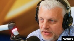 FILE - Journalist Pavel Sheremet talks on the air at a radio station in Kiev, Ukraine, October 11, 2015.