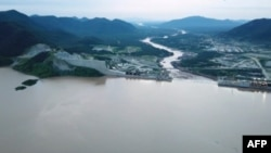 FILE - This frame grab from a video obtained from the Ethiopian Public Broadcaster on July 24, 2020, shows an aerial view of water levels at the Grand Ethiopian Renaissance Dam in Guba, Ethiopia.