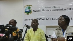 National Elections Commission Chairman James Fromayan (C) delivers the first results of Liberia's presidential election during a news conference in Monrovia, October 13, 2011.