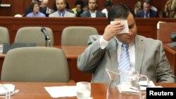 George Zimmerman se limpia el sudor durante el juicio original en Sanford, Florida, en julio de 2013. El Departamento de Justicia ya no le presentará más cargos por la muerte de Trayvon Martin.