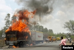 A truck burns during a farmers protest on a highway near Bhopal in the central state of Madhya Pradesh, India, June 9, 2017.