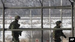 South Korean border guards patrol the fence-line at the Imjingak Pavilion near the border village of Panmunjom in Paju, 01 Jan 2011