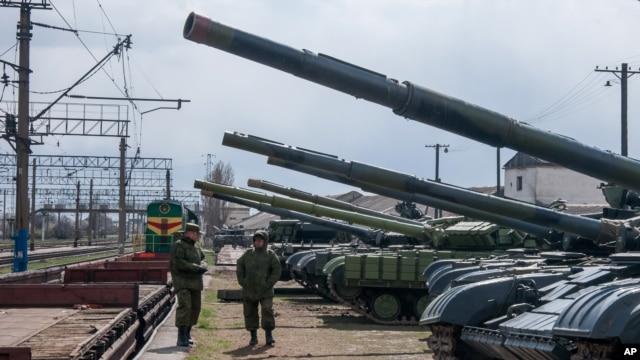 Ukrainian armored vehicles are prepared for loading onto a train at a railway station near Simferopol, Crimea.