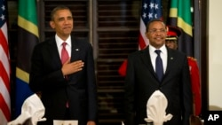 President Barack Obama and Tanzanian President Jakaya Kikwete stand for the national anthem during an official dinner at the State House in Dar es Salaam, Tanzania, July 1, 2013.