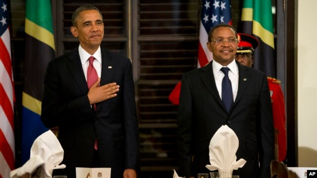 FILE - President Barack Obama and Tanzanian President Jakaya Kikwete stand for the national anthem during an official dinner at the State House in Dar es Salaam, Tanzania, July 1, 2013.
