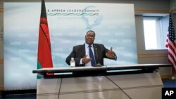 FILE - Malawi's President Peter Mutharika meets with reporters at the conclusion of the US-Africa Summit at the Institute of Peace in Washington in August.