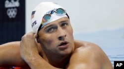 United States' Ryan Lochte checks his time in a men's 4x200-meter freestyle heat during the swimming competitions at the 2016 Summer Olympics, in Rio de Janeiro, Brazil, August 9, 2016.